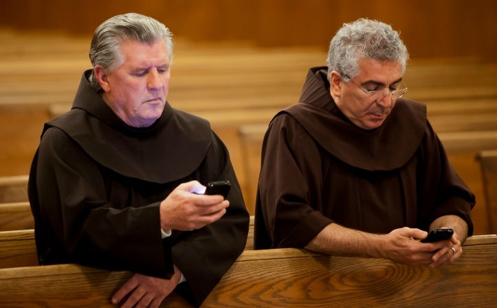 Franciscan brothers read prayer requests from cell phones at New Jersey friary
